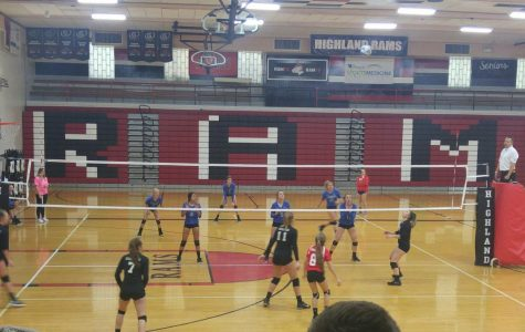 HIGHLAND FRESHMAN SCORING- Lauren Harding, number 19, getting ready to set the ball gaining a point for HHS.