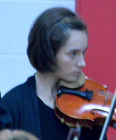 June Johnson playing the violin at the Orchestra performance in Highland's main gym. The performance took place on October 24, 2018.