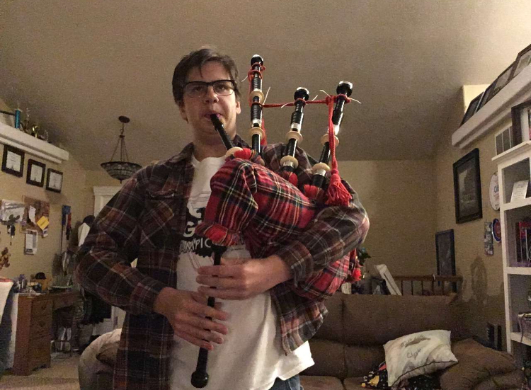 Tristan Pinkerton practicing Amazing Grace on the bagpipe in his living room. This photo was taken on November 15, 2018.