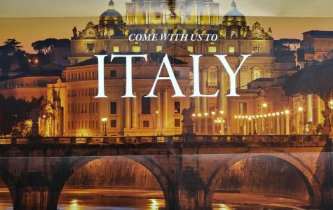Poster advertising the trip to Italy hanging around the school