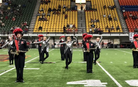 Cheerleaders and marching band perform in Saturday's halftime show