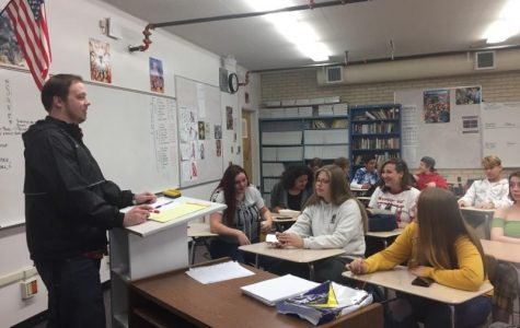 Mr.Mark Ritcher teaching the new students in his first hour Broadcasting class