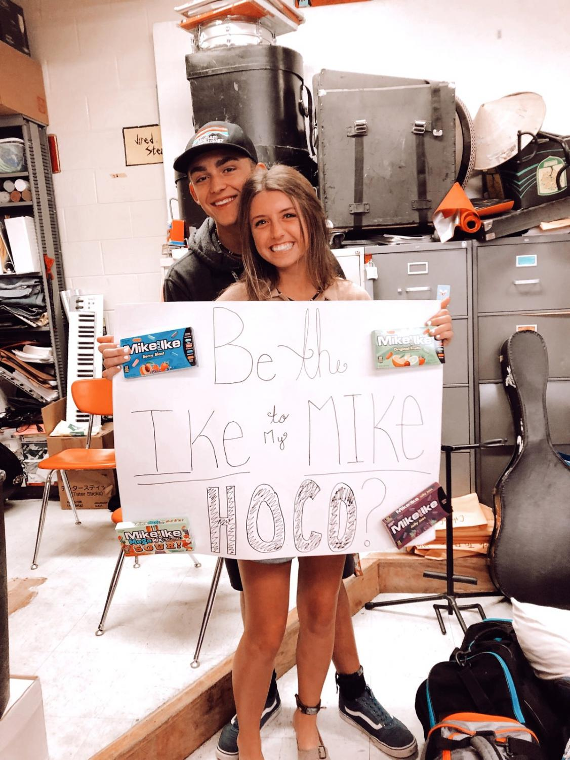Being asked to homecoming by Logan Brizzee asked Lauren Benson by having a poster
