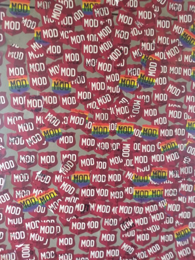 The+stickers+of+previous+customers+on+the+wall+of+Mod+Pizza.+Picture+by+Cadence+Andrus+