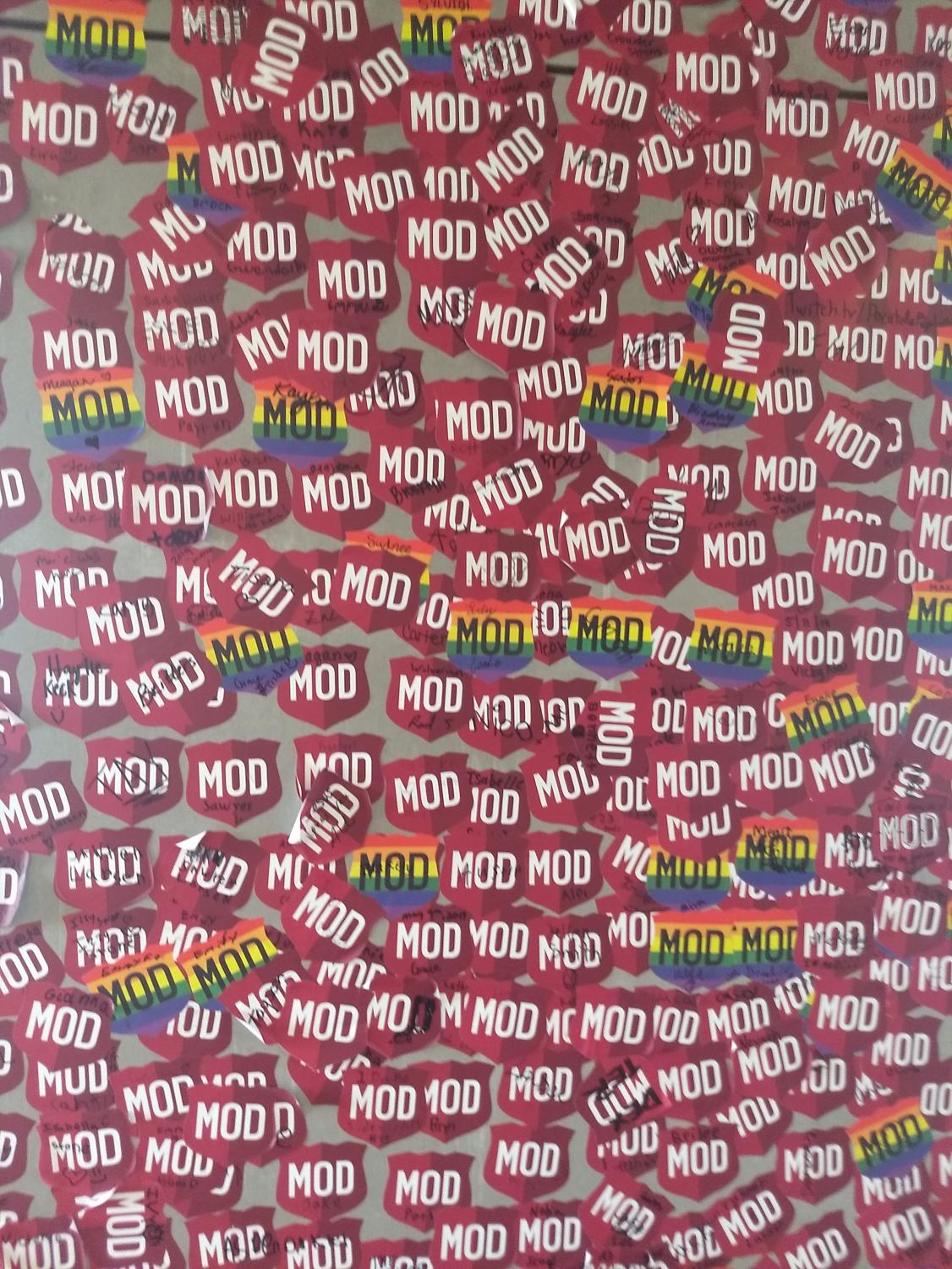 The stickers of previous customers on the wall of Mod Pizza. Picture by Cadence Andrus