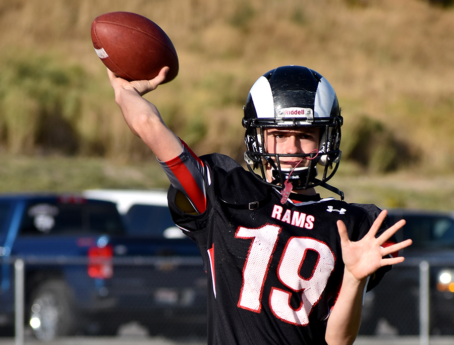 Mason Lemmon prepares to throw the football downfield in the game against Pocatello High School.