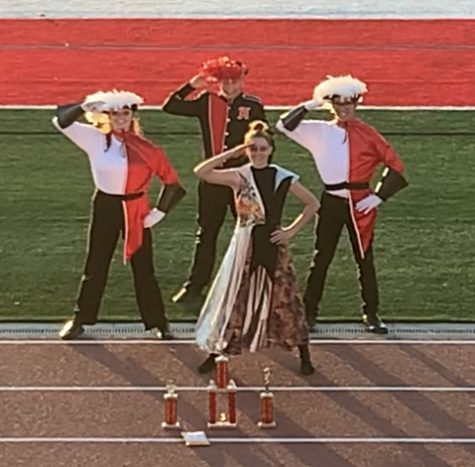 Amanda Smith, Tanner Mulkay, Amber Asper, and _____ at the Mt. Tippanogous marching band competition.