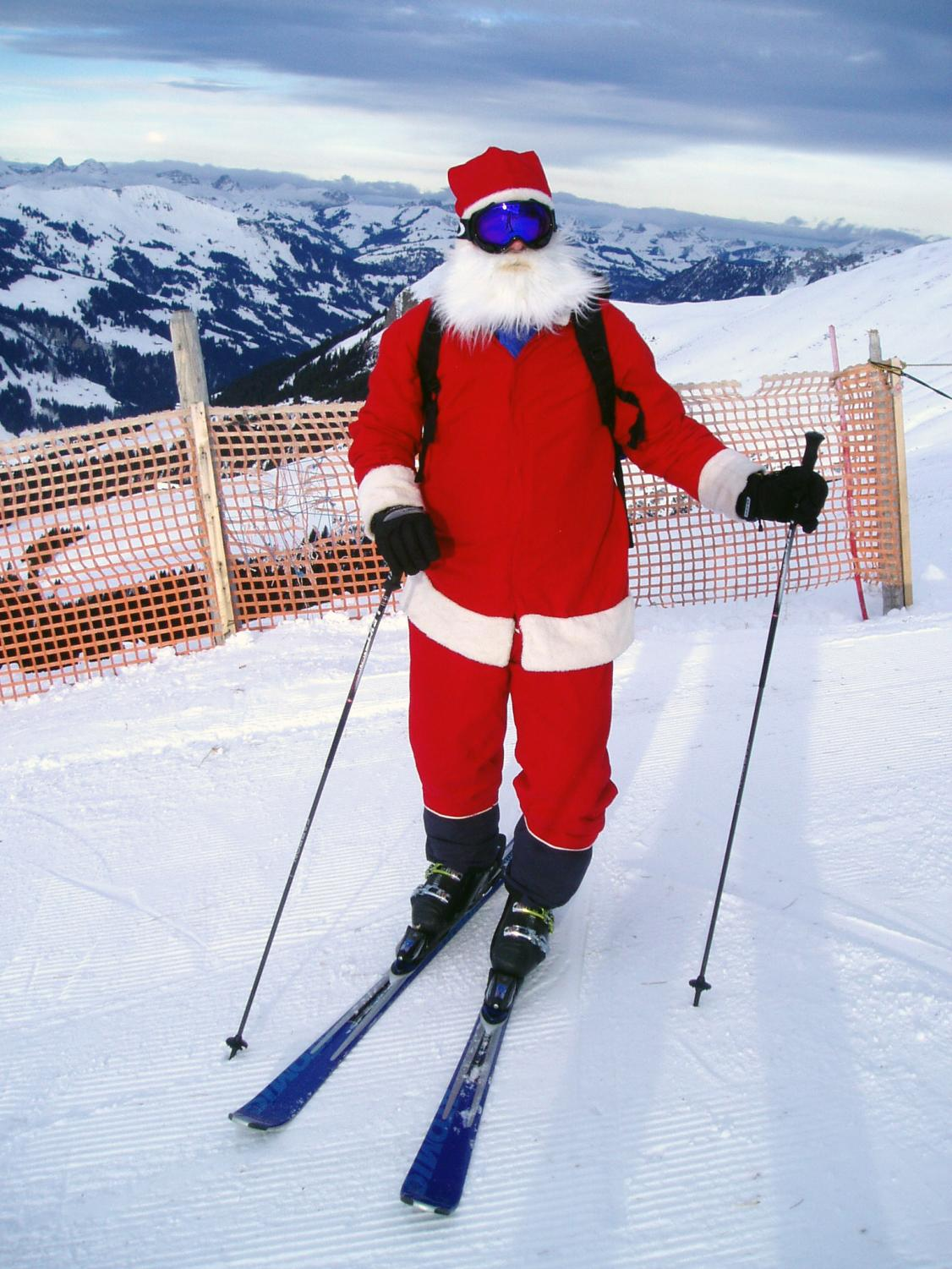 Santa having fun skiing in Switzerland.