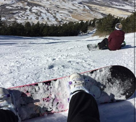 Zoe Christensen overlooking Pebble Creek on her snowboard