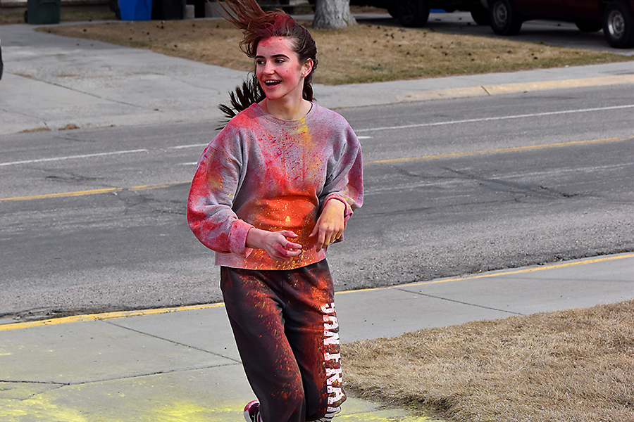 A participant comes into the final leg of the color run as part of a fundraiser for Make A Wish.