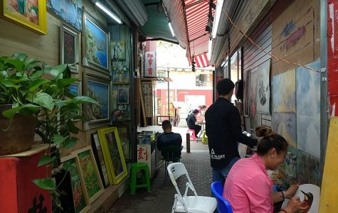 Artists at work in Dafen Oil Painting Village