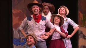 A family (LaurenLopez, JeffBlim, Rachael Soglin, Jaime Lyn Beatty, and Corey Dorris) preparing to go on the Oregon Trail in the musical The Trail to Oregon.