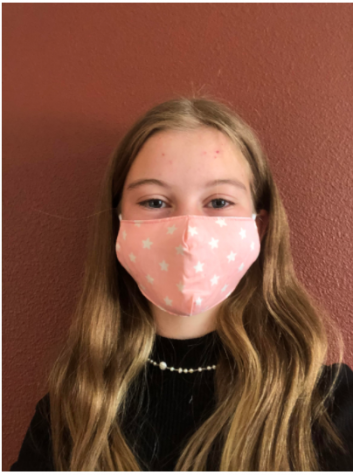 Mila Gabiola smiling with a mask on September 22 at her house.