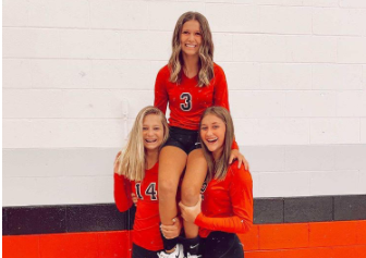 Jenna Riley, Abby Moore, and Kaylen pose on picture day at Highland high school.