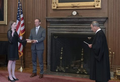 Taken October 27, 2020. Chief Justice John G. Roberts, Jr., administers the Judicial Oath to Judge Amy Coney Barrett in the East Conference Room, Supreme Court Building. Judge Barrett