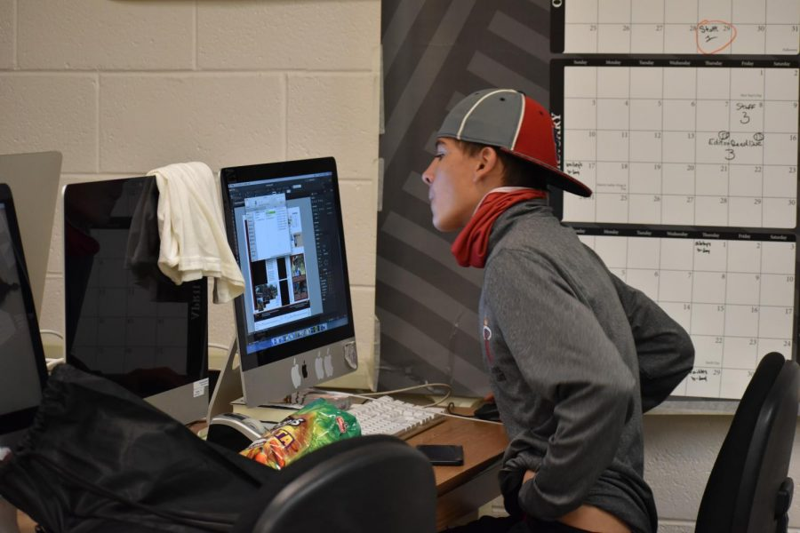 Clubs editor Payson Lucero, junior, works on the soccer spread using Adobe InDesign.