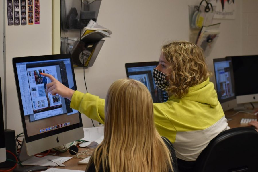 Editor Abby Page works with staffer Aidan Merrill on a student life spread for the yearbook.