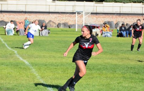 Grace Fisher rides the line of the soccer field waiting for the ball.