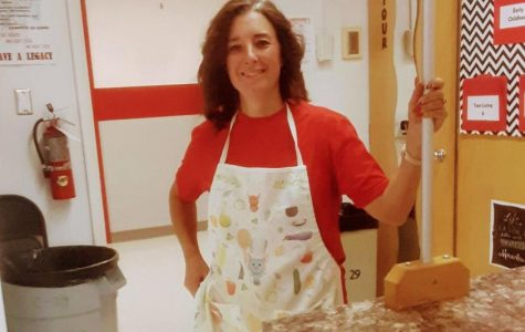 FCCLA advisor, Mrs. Jenkins poses for a photo in her natural habitat: her cooking classroom.