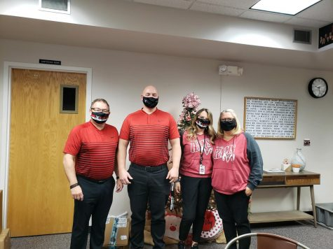 Principal and teachers dress up for twin day.