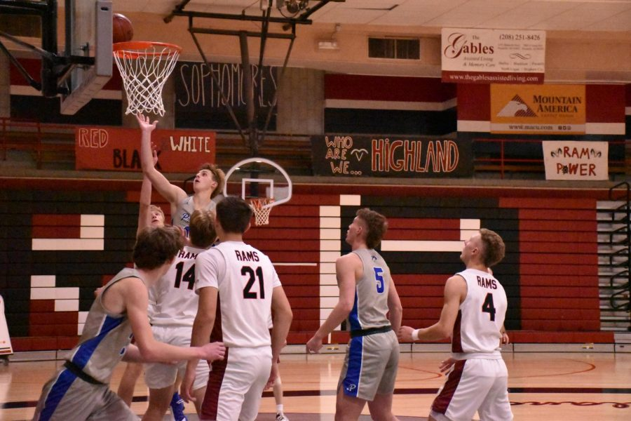 Preston makes a basket as Highland players watch, knowing its too far to stop it now.