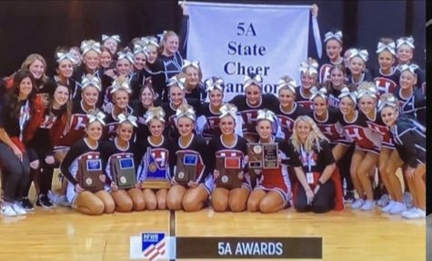 Highland High School cheerleaders pose for a picture at state competition.