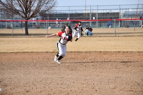 Kendall Kearns, grade 10, runs to catch a fly ball in the infield at the opening jamboree.