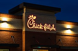 A Chick-fil-A fast food restaurant location on an early summer evening in West St. Paul, Minnesota.