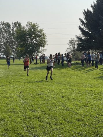 One of the cross country boy running to the finish line